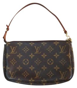 Louis Vuitton Leather Monogram Wristlet in Brown