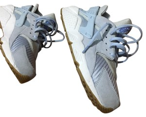 Nike huarache light blue with brown gum bottom. Athletic