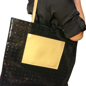 Arcadia Tote in Black with tan leather handle and front pocket