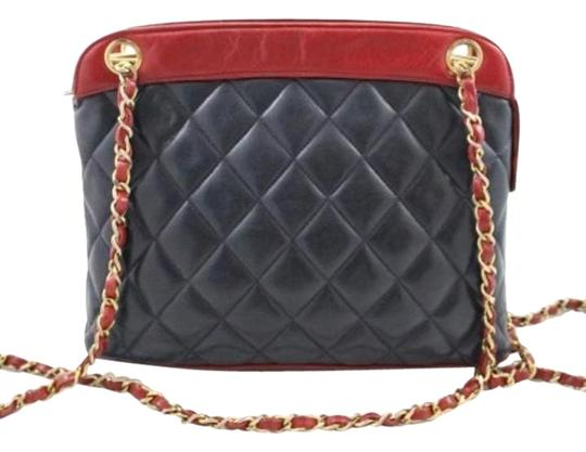 Preload https://item4.tradesy.com/images/chanel-two-toned-quilted-navyred-leather-shoulder-bag-2113753-0-3.jpg?width=440&height=440