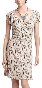 Anthropologie short dress Beige Cap Sleeve Print on Tradesy