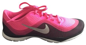 Nike pink and black with a silver swish Athletic