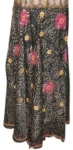 Alka Vora Silk Comfortable Dryclean Only Vintage Sparkle Maxi Skirt Black background with tiny mirrors, red threads and tiny gray squares