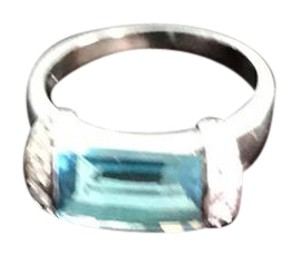 Nordstrom 925 coded sterling silver blue topaz ring with diamond chip accents on the side.
