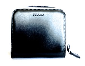 Prada PRADA1MO522 VITELLO BI-FOLD WALLET IN BLACK WITH IVORY PIPING $560.00