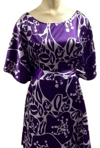Vertigo short dress Purple, White on Tradesy