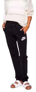 Nike Women's Nike Rally Loose Sweatpants are comfortable and loose fit that gives you plenty of room to move. Fits baggy. Materials: 80% cotton, 20% polyester. Style/Color: 545755-013