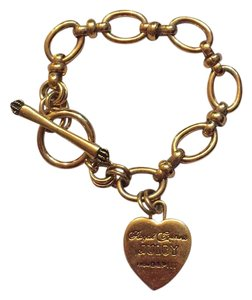 Juicy Couture Gold color chain and charm bracelet
