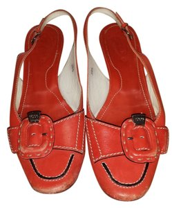 Tod's Orange Pumps