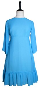Lisa Nieves short dress Light turquoise on Tradesy