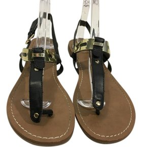 Dolce Vita Black flat thong with ankle straps gold front Sandals