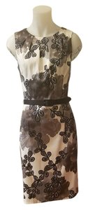 Dress Barn short dress Base is white with black and sliver design on Tradesy