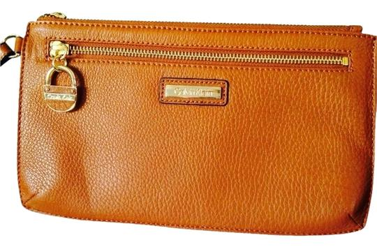 Preload https://item4.tradesy.com/images/calvin-klein-cocoa-leather-wristlet-2117718-0-0.jpg?width=440&height=440
