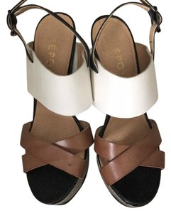 REPORT Brown, White, Black Wedges