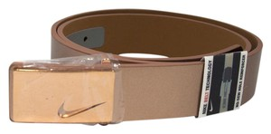 Nike size M metallic rose gold tone genuine leather belt