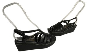 Donald J. Pliner Lots Lining Soles White Topstitching Black strappy leather with many cut outs ankle straps Italian open toe Wedges
