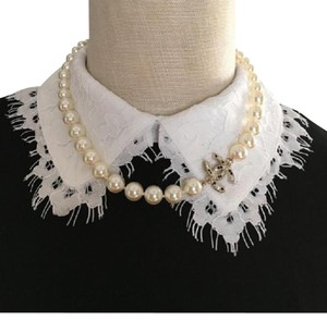 Chanel classic channel white pearl choker necklace.