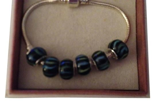 Preload https://item5.tradesy.com/images/bella-and-chloe-black-with-blue-stripes-set-of-6-european-style-murano-lampwork-glass-beads-beads-ar-2119569-0-0.jpg?width=440&height=440