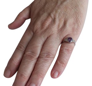 Other Stunning Sterling Silver Ring with Purple Center Stone and 6 Small CZs