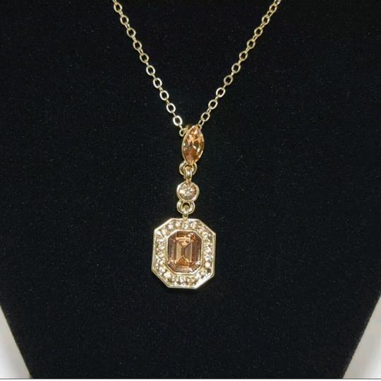 Carolee Gold tone crystal pendant necklace