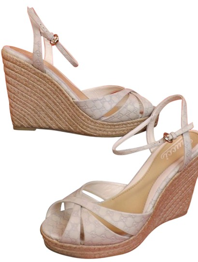 Preload https://img-static.tradesy.com/item/21203427/gucci-white-off-guccissima-gg-leather-wedge-sandals-platforms-size-us-115-regular-m-b-0-1-540-540.jpg