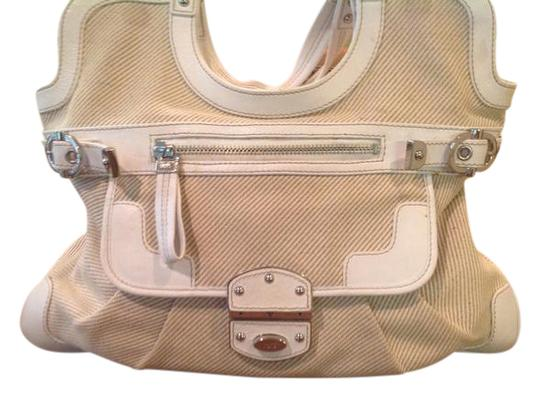 Preload https://img-static.tradesy.com/item/21204358/rafe-white-leather-and-cream-canvas-tote-0-1-540-540.jpg