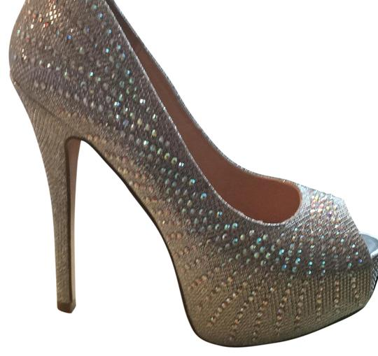 Preload https://img-static.tradesy.com/item/21205628/cathy-jean-silver-sparkle-platforms-size-us-65-regular-m-b-0-1-540-540.jpg