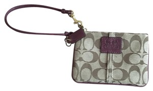 Coach Wristlet in tan w cranberry strap