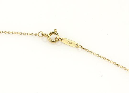 Tiffany & Co. 15973 . Tiffany & Co. 18k Gold Classic Mini Gift Box Pendant
