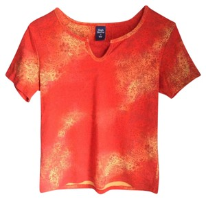 High Sierra Top Red, Orange, and Yellow with brownish floral pattern all over.