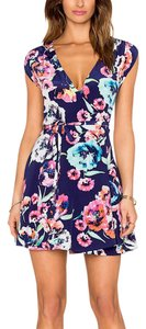 Yumi Kim short dress Blue Silk Black Floral Classic Sleek Chic Wrap Around Printed Silky Mini on Tradesy