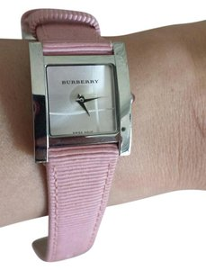 Burberry Authentic Burberry Watch with a silver display and a pink wristband