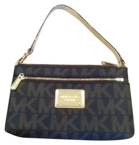 Michael Kors Wristlet in Dark Brown/medium Brown In A Pattern That Shows MK Initials