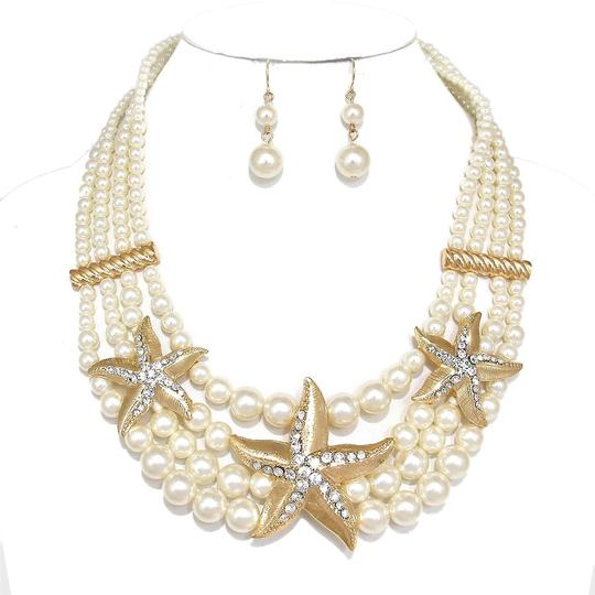 Preload https://item4.tradesy.com/images/other-crystal-accent-starfish-pearl-cluster-necklace-and-earrings-2123123-0-0.jpg?width=440&height=440