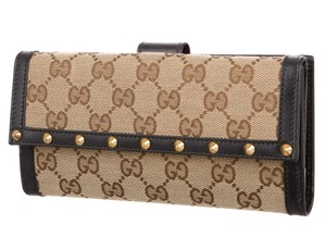 Gucci Brown, tan GG web monogram canvas Gucci studded wallet