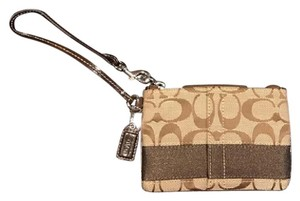 Coach Signature Wristlet in Dark and Light Brown