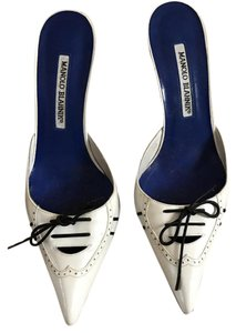 Manolo Blahnik while/ Blue Pumps
