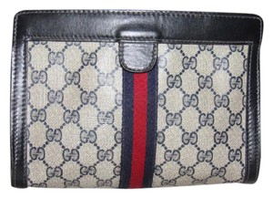 Gucci Great Everyday Cosmetic / Great For Travel Velcro Top Closure Early navy leather/large G logo print coated canvas & leather with red/blue stripe Clutch