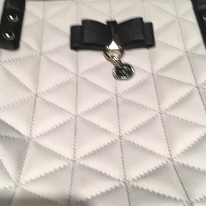 Jessica Simpson Tote in cream with black handles and bow with charm