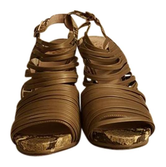 Preload https://img-static.tradesy.com/item/21243955/vince-camuto-taupe-strappy-faux-snakeskin-sandals-size-us-95-regular-m-b-0-1-540-540.jpg