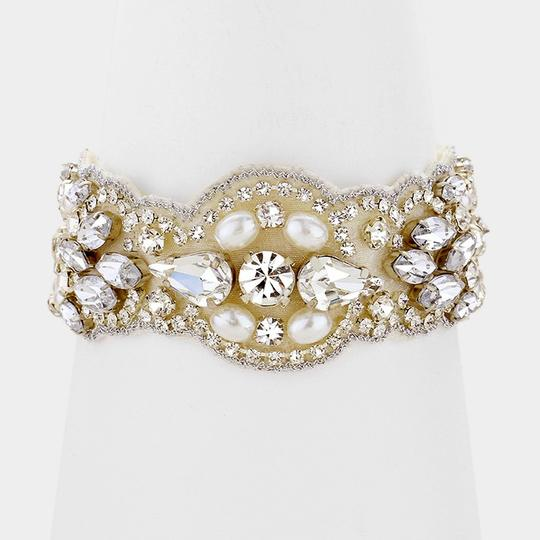 Preload https://img-static.tradesy.com/item/21244958/silver-bridal-pearl-and-crystal-embellished-stretch-bracelet-other-0-0-540-540.jpg