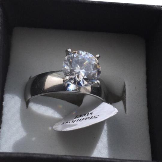 Preload https://item1.tradesy.com/images/silver-2-cttw-cz-solitaire-diamond-ring-21246795-0-1.jpg?width=440&height=440