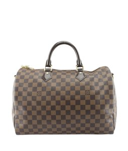 Louis Vuitton Coated Canvas Satchel in Brown