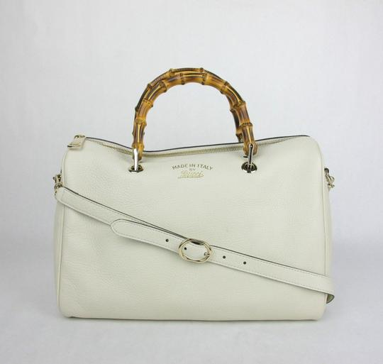Preload https://item4.tradesy.com/images/gucci-boston-bamboo-shopper-with-bamboo-handles-353124-9022-white-leather-satchel-21258643-0-0.jpg?width=440&height=440