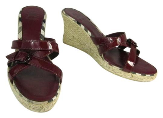Preload https://item1.tradesy.com/images/burberry-red-leather-and-nova-check-wedges-sandals-size-us-95-regular-m-b-21259430-0-1.jpg?width=440&height=440
