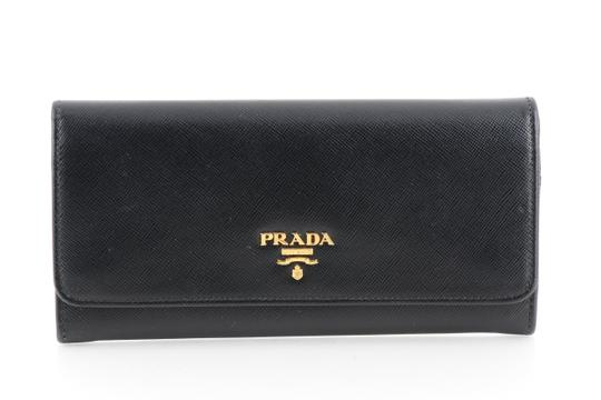 Preload https://img-static.tradesy.com/item/21259939/prada-black-saffiano-leather-continental-flap-wallet-0-2-540-540.jpg