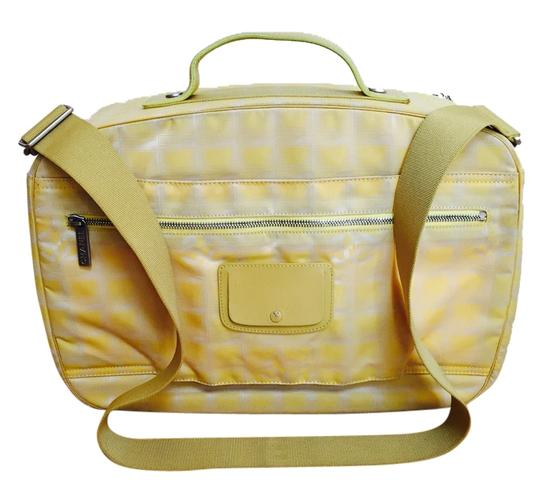 Preload https://img-static.tradesy.com/item/2126072/chanel-line-overnight-yellow-canvas-and-leather-weekendtravel-bag-0-0-540-540.jpg
