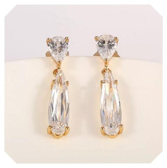 Preload https://img-static.tradesy.com/item/21261348/yellow-gold-tone-new-white-sapphire-crystal-earrings-0-1-540-540.jpg