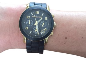 Michael Kors black and gold women's oversized watch