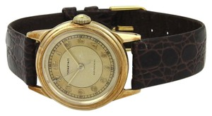 Tiffany & Co. Vintage 14k Yellow Gold Cal 470 Winding Round Leather Band Watch 44760